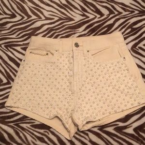 Off white denim BDG shorts with pearl accents